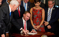 Former United States Representative Mick Mulvaney (Republican of South Carolina) signs the signs the affidavit of appointment after being sworn-in to be Director of the Office of Management and Budget (OMB) by US Vice President Mike Pence, left, in the Vice President's Ceremonial Office at the White House in Washington, DC on Thursday, February 16, 2017.<br /> Credit: Ron Sachs / Pool via CNP /MediaPunch