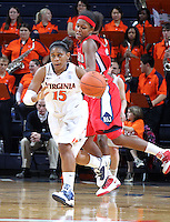 Dec. 6, 2010; Charlottesville, VA, USA; Virginia Cavaliers guard Ariana Moorer (15) drives past Radford Highlanders guard/forward Brooke McElroy (20) at the John Paul Jones Arena. Virginia won 76-52. Mandatory Credit: Andrew Shurtleff