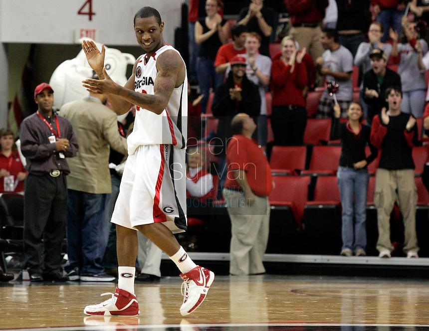 University of Georgia guard Mike Mercer and fans celebrate his airborne dunk against Wisconsin in the first half in Athens, Ga. on Sunday, Dec. 31, 2006.
