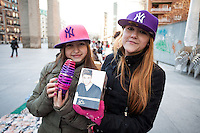 Andrea (15 years) and Luci (8 years), two fans waiting  for the concert of Justin Bieber at the Palacio de los deportes in Madrid