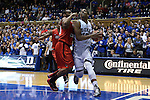 08 November 2014: Duke's Jahlil Okafor (right) and Central Missouri's Brennen Hughes (left). The Duke University Blue Devils hosted the University of Central Missouri Mules at Cameron Indoor Stadium in Durham, North Carolina in an NCAA Men's Basketball exhibition game. Duke won the game 87-47.