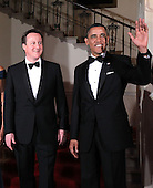 U.S. President Barack Obama (R) and British Prime Minister David Cameron (L) pose for an official photo at the Grand Staircase of the White House March 14, 2012 in Washington, DC. Prime Minister Cameron was on a three-day visit in the U.S. and he had talks with President Obama earlier the day.  .Credit: Alex Wong / Pool via CNP