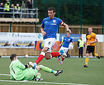 Annan keeper Alex Mitchell gets down to save before Lee McCulloch arrives