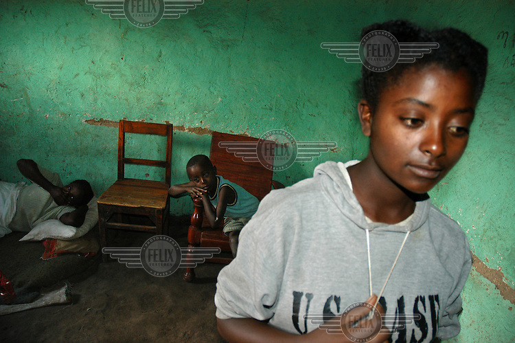 15 year old Benyam Tsege, an orphan who lives with the Etagenghu Merid family. The family has five children and all together lives in one single room. Benyam attends a boarding high school founded by the Czech NGO People in Need..