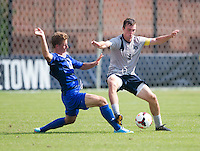 Joey Dillon (4) of Georgetown fights for the ball with Samuel Geiler (21) of Seton Hall during the game at Shaw Field in Washington, DC.  Georgetown defeated Seton Hall, 8-0.