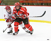 Gina McDonald (Harvard - 10), Kelly Sabatine (St. Lawrence - 16) - The Harvard University Crimson defeated the St. Lawrence University Saints 8-3 (EN) to win their ECAC Quarterfinals on Saturday, February 26, 2011, at Bright Hockey Center in Cambridge, Massachusetts.