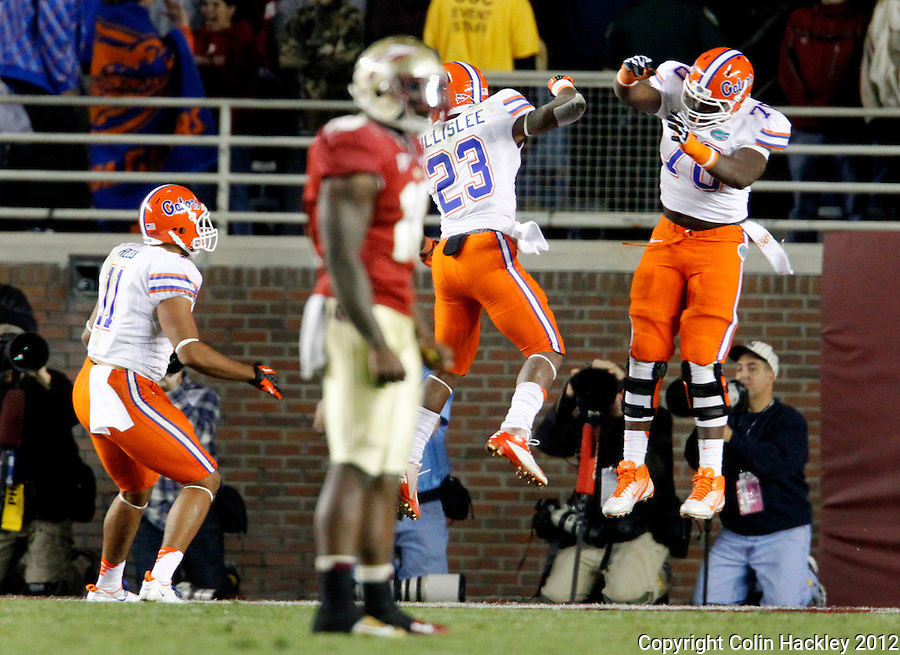 TALLAHASSEE, FL 11/24/12-FSU-UF112412 CH-Florida's Mike Gillislee, center, celebrates his go-ahead touchdown with Ronald Powell, right, and Jordan Reed during second half action Saturday at Doak Campbell Stadium in Tallahassee. The play before FSU's EJ Manuel fumbled. The Gators beat the Seminoles 37-26..COLIN HACKLEY PHOTO