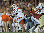 Defensive end Mario Edwards Jr gets a hand on Auburn quarterback Nick Marshall during the BCS national title game at the Rose Bowl in Pasadena, California on January 6, 2014.   The Florida State Seminoles defeated the Auburn Tiger 34-31 to win the final BCS National Championship.