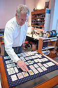 """Tom Whiteside, owner of Durham Cinematheque, arranges the second deck for his installation; """"Cards: Two Decks"""" on Thursday June 28th 2012."""