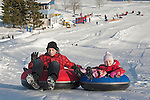 Happy Smiling Young Girl Kid and Teenage Boy on Otepää Snowtubing Track,  Estonia