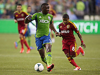 Jhon Kennedy Hurtado, left, of the Seattle Sounders FC dribbles the ball in front of Joao Plata of Real Salt Lake during play at CenturyLink Field in Seattle Friday September 13, 2013. The Sounders won the match 2-0.