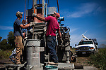 NELSON, CA - AUGUST 12: Jeremy Clinkenbeard, left, and Jon, right, drill a new water well on the edge of a rice field in the Central Valley. (Photo by Max Whittaker/Prime for The Washington Post)