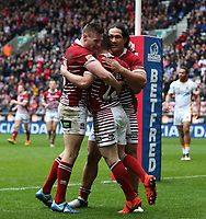 Wigan Warriors' Morgan Escare (centre) celebrates scoring his sides first try <br /> <br /> Photographer Stephen White/CameraSport<br /> <br /> Betfred Super League Round 5 - Wigan Warriors v Huddersfield Giants - Sunday 19th March 2017 - DW Stadium - Wigan<br /> <br /> World Copyright &copy; 2017 CameraSport. All rights reserved. 43 Linden Ave. Countesthorpe. Leicester. England. LE8 5PG - Tel: +44 (0) 116 277 4147 - admin@camerasport.com - www.camerasport.com