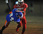 Lafayette High's D.K. Buford (2) runs vs. North Pontotoc's Ben Shannon (24) at William L. Buford Stadium in Oxford, Miss. on Thursday, October 27, 2011. Lafayette High won 49-7.