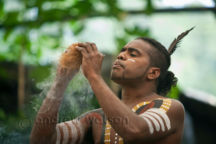 Indigenous performer using traditional methods to make fire at Tjapukai Aboriginal Cultural Park.  Smithfield, Cairns, Queensland, Australia