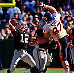 Oakland Raiders vs. Chicago Bears at Oakland Alameda County Coliseum Sunday, September 26, 1999.  Raiders bet Bears  24-17.  Oakland Raiders quarterback Rich Gannon (12) attempts to pass over Chicago Bears defensive tackle Mike Wells (97).