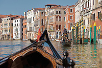Gondola on the Grand Canal, Venice, Italy. Many of the houses and palazzos fronting the canals are in Venetian Gothic style, a style originating in the 14th century and combining Gothic lancet arches with Byzantine and Moorish influences. The city of Venice is an archipelago of 117 small islands separated by canals and linked by bridges, in the Venetian Lagoon. The historical centre of Venice is listed as a UNESCO World Heritage Site. Picture by Manuel Cohen