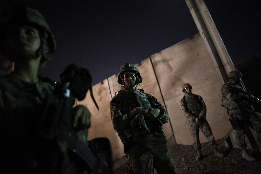 American support troops stationed at Kandahar Airfield - one of the largest coalition logistics bases in Afghanistan and the hub of the American-led expansion of the war effort in the Afghan south - take up positions guarding buildings and civilian workers in the base's interior after an attack by Taliban fighters aimed at breaching the airfield's security perimeter on Saturday May 23, 2010. The attack, which was comprised of a series of rocket strikes and an unsuccessful assault using small arms fire and a suicide bomber, reportedly left five Americans wounded and was the second such raid on a major Western base in the last week.