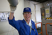 Hisao Kitawaki (73 years old, in 8th year of working for Kato company) is an elderly worker at Kato (a light industry company) in Nakatsugawa, Japan, Monday 21st June 2010. Kato company has a workforce of 100 people, 50% of whom are 60 years of age or older. The elderly work force earn JPN &yen;800-1,000 per hour, but receive no annual bonus or pay rise.