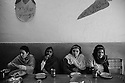 Four members of the Rose Garden rehabilitation center of the Punjab Institute of Mental Health are having lunch after their morning vocational training. Lahore, Pakistan, 2009
