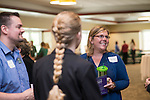 Megan Vogel, Special Assistant to the Vice President for Student Affairs and Director of Resource Administration, talks to a small group of people at the Campus Communicator Network Expo in Nelson Commons on Wednesday, May 11, 2016. © Ohio University / Photo by Kaitlin Owens