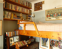 Favourite books are within easy reach at bedtime in this children's bedroom
