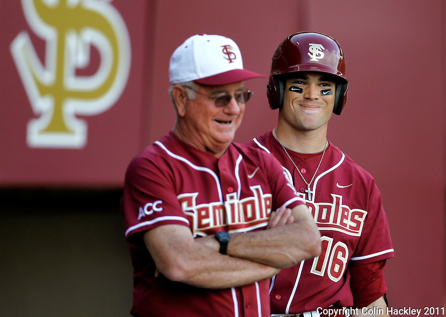 TALLAHASSEE, FL 2/18/11-FSU-VMI BASE11 CH-Florida State Head Coach Mike Martin, left, and Jayce Boyd enjoy a laugh during the Virginia Military Institute game Friday at Dick Howser Stadium in Tallahassee. The Seminoles beat the Keydets 12-0 in the season opener for both teams..COLIN HACKLEY PHOTO