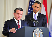 King Abdullah II of Jordan makes remarks as United States President Barack Obama looks on in the East Room of the White House following a series bi-lateral meetings in Washington, D.C. on Wednesday, September 1, 2010.  The statements are in advance of the opening of the first direct talks in two years between Israel and the Palestinian Authority scheduled to begin at the State Department in Washington, D.C. tomorrow.  .Credit: Ron Sachs / Pool via CNP.(RESTRICTION: NO New York or New Jersey Newspapers or newspapers within a 75 mile radius of New York City)