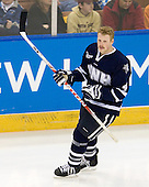 Damon Kipp (UNH - 4) - The University of New Hampshire Wildcats defeated the Miami University RedHawks 3-1 (EN) in their NCAA Northeast Regional Semi-Final on Saturday, March 26, 2011, at Verizon Wireless Arena in Manchester, New Hampshire.