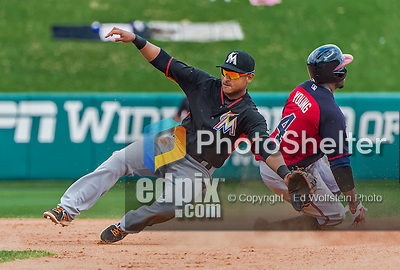 19 March 2015: Miami Marlins infielder Donovan Solano is unable to stop Eric Young Jr. from stealing but keeps the ball from going wild during Spring Training action against the Atlanta Braves at Champion Stadium in the ESPN Wide World of Sports Complex in Kissimmee, Florida. The Braves defeated the Marlins 6-3 in Grapefruit League play. Mandatory Credit: Ed Wolfstein Photo *** RAW (NEF) Image File Available ***