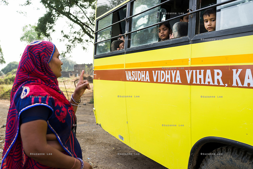 Sugna Jat, 30, speaks to her son Hemant Jat, 6, through the bus window in Maheshwar, Khargone, Madhya Pradesh, India on 13 November 2014. Hemant, the son of Fairtrade cotton farmers, wants to be a police man when he grows up and gets a 5% discount of school fees at the Vasudha school. His parents would be happy if Hemant took over the farm but if he does well in school, he could look for other careers. Photo by Suzanne Lee for Fairtrade
