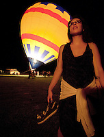 A young woman watches as hot air balloons are inflated in a field near Fredericksburg, Texas, Friday, July 24, 2009. (Darren Abate/pressphotointl.com)