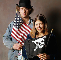 Young hippie type characters with american pirate skull and cross bones flag Americana