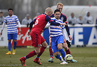 Mauro Zarate of QPR skips past Eric Gehrig of Chicago Fire