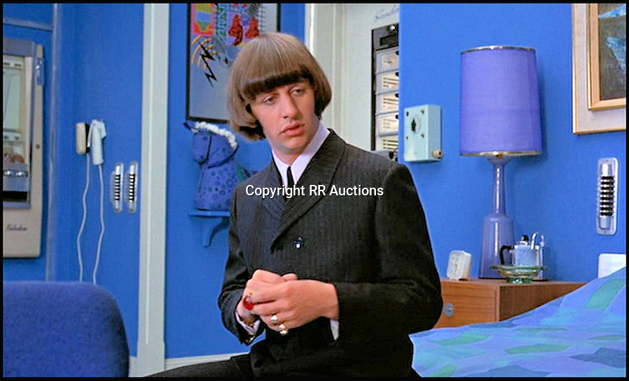 BNPS.co.uk (01202 558833)<br /> Pic: RRAuctions/BNPS<br /> <br /> The simple suit jacket that Beatles drummer Ringo Starr wore in the Fab Four's hit film Help! has gone on sale for a staggering &pound;35,000 50 years after its release.<br /> <br /> Ringo donned the double-breasted black wool jacket in a pivotal scene in the 1965 movie, a comedy adventure following the Beatles as they battled an evil occult.<br /> <br /> The jacket, made by Beatles tailors D.A. Millings &amp; Sons, was gifted by Ringo's parents Elsie and Harry to family friends in the late 1960s after they visited them at their home in Liverpool.<br /> <br /> The jacket is now tipped to fetch a massive $50,000 - around &pound;35,000 - when it goes under the hammer at RR Auction in Boston, US, on July 23.