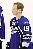 Dan Baco (Niagara - 19) - The visiting Niagara University Purple Eagles defeated the Northeastern University Huskies 4-1 on Friday, November 5, 2010, at Matthews Arena in Boston, Massachusetts.