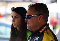 Sept. 28, 2012; Madison, IL, USA: NHRA funny car driver Jeff Arend (right) with teammate Alexis DeJoria during qualifying for the Midwest Nationals at Gateway Motorsports Park. Mandatory Credit: Mark J. Rebilas-