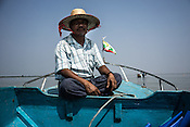 49 year old Win Shwe, the Chairman of the village fisheries society poses for a photo while on a boat on river Bogale near Damin Naung village in Pyapon district of Myanmar.