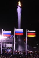 OLYMPICS: SOCHI: Medal Plaza, 13-02-2014, medaille uitreiking, Figure Skating, Pairs, Olympische vlam en vlaggen, ©foto Martin de Jong