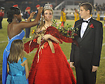 Senior maid Emily Gardner (center), with escort Clyde Burgos (right), was crowned homecoming queen by Mykira Buford at Lafayette High vs. Tunica Rosa Fort in Oxford, Miss. on Friday, October 5, 2012. Lafayette High won 35-6.
