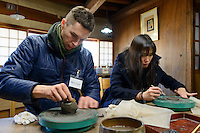 Tour participant Max Lexy making a Bizen-yaki sake cup. Bizen city, Okayama Pref, Japan, January 29, 2014. Okayama is famous for its earthy full-bodied sake. In January and February 2014 a 5-day tour of breweries in the prefecture was organised by Sake Brewery Tours (www.saketours.com).