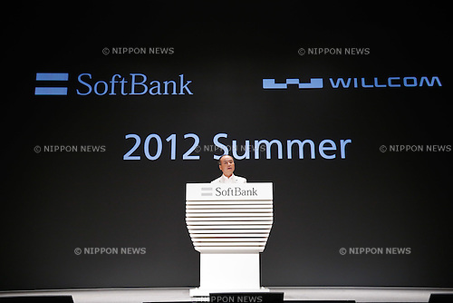 May 29, 2012, Tokyo, Japan - President Masayoshi Son of Softbank introduces a lineup of new smartphones and services during a launch of its 2012 summer models in Tokyo on Tuesday, May 29, 2012. ..Among the new lineup, the Sharp Pantone 5 107SH, an Andoroid 4.0 smartphone, draws attention to its radiation detecting feature. Japans third largest mobile service provider will start using for telecommunications services from July 25 the so-called platinum band, in which waves can travel long distances by circumventing obstacles. (Photo by AFLO) UUK -mis-.