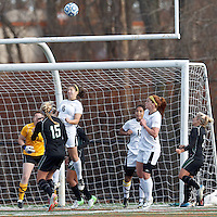 Corner kick: College of St Rose forward Kyra Meli (6) heads the ball. . In 2012 NCAA Division II Women's Soccer Championship Tournament First Round, College of St Rose (white) defeated Wilmington University (black), 3-0, on Ronald J. Abdow Field at American International College on November 9, 2012.