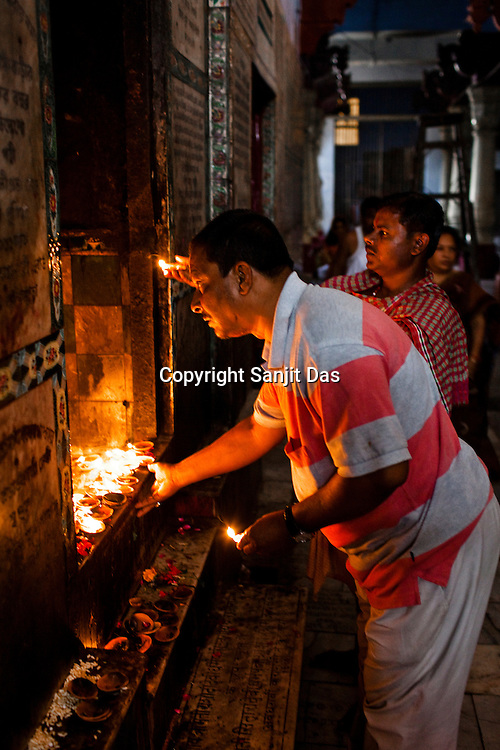 Hindu Pilgrims visit and offer prayers at the Gauri Kedareshwar temple  on Kedar Ghat in the ancient city of Varanasi in Uttar Pradesh, India. Photograph: Sanjit Das/Panos