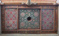 View from below of tiles on the ceiling of the aiwan of the Arzkhona, or courtroom, Tash Khauli Palace, 1830-38, Khiva, Uzbekistan, Khiva, Uzbekistan, pictured on July 7, 2010, in the afternoon. Commissioned by Allah Kuli Khan the Tash Kauli palace is a huge complex containing 163 rooms which took its architects, Tajiddin and Kalandar, 10 years to build. The harem, occupying about half of the palace has 5 aiwan terraces, with delicately carved wooden pillars,  behind which were the quarters for the khan and his wives. Khiva, ancient and remote, is the most intact Silk Road city. Ichan Kala, its old town, was the first site in Uzbekistan to become a World Heritage Site(1991). Picture by Manuel Cohen.