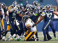 Ahtyba Rubin #77 of the Seattle Seahawks celebrates his interception in front of Marcus Gilbert #77 of the Pittsburgh Steelers in the second half during the game at CenturyLink Field on November 29, 2015 in Seattle, Washington. (Photo by Jared Wickerham/DKPittsburghSports)