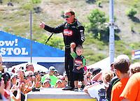 Jun 19, 2016; Bristol, TN, USA; NHRA top fuel driver Terry McMillen with son Cameron McMillen during the Thunder Valley Nationals at Bristol Dragway. Mandatory Credit: Mark J. Rebilas-USA TODAY Sports