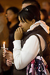 Stephanie James, right, grieves during a light prayer vigil at the Champion's Centre in Tacoma WA., for family members, friends and law enforcement officers for four Lakewood Police officers killed at a Lakewood coffee shop on Sunday, Nov. 29, 2009.  At about 8:00 a.m. Sunday morning, a gunman walked into the Forza Coffee shop and while the four police officers were having coffee before their shift started, he opened fire, killing all four law enforcement officers. James, who's husband is also a Lakewood poice officer knew the police officers killed.Jim Bryant Photo. ©2010. ALL RIGHTS RESERVED.