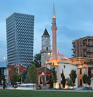 The Et'hem Bey Mosque or Xhamia e Et'hem Beut, begun 1789 by Molla Bey and finished in 1823 by his son Haxhi Ethem Bey, great-grandson of Sulejman Pasha, and behind, the Clock Tower of Tirana or Kulla e Sahatit, 35m high, built in 1822 by Haxhi Et'hem Bey, Tirana, Albania. The mosque is listed as a Cultural Monument of Albania. Tirana was founded by the Ottomans in 1614 by Sulejman Bargjini and became the capital of Albania in 1920. Picture by Manuel Cohen
