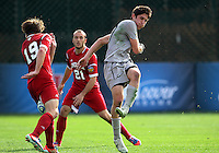 HOOVER, AL - DECEMBER 09, 2012: Patrick Doody (19) of Indiana University stops a shot by Andy Riemer (20)  of Georgetown University during the NCAA 2012 Men's College Cup championship, at Regions Park, in Hoover , AL, on Sunday, December 09, 2012.
